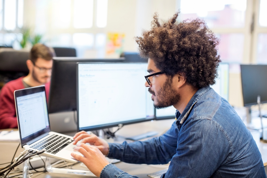 Man with afro hairstyle working at his desk