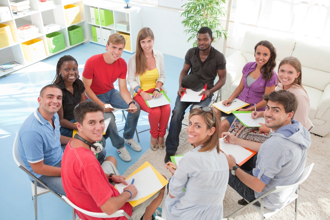 Group of students sitting in a circle.