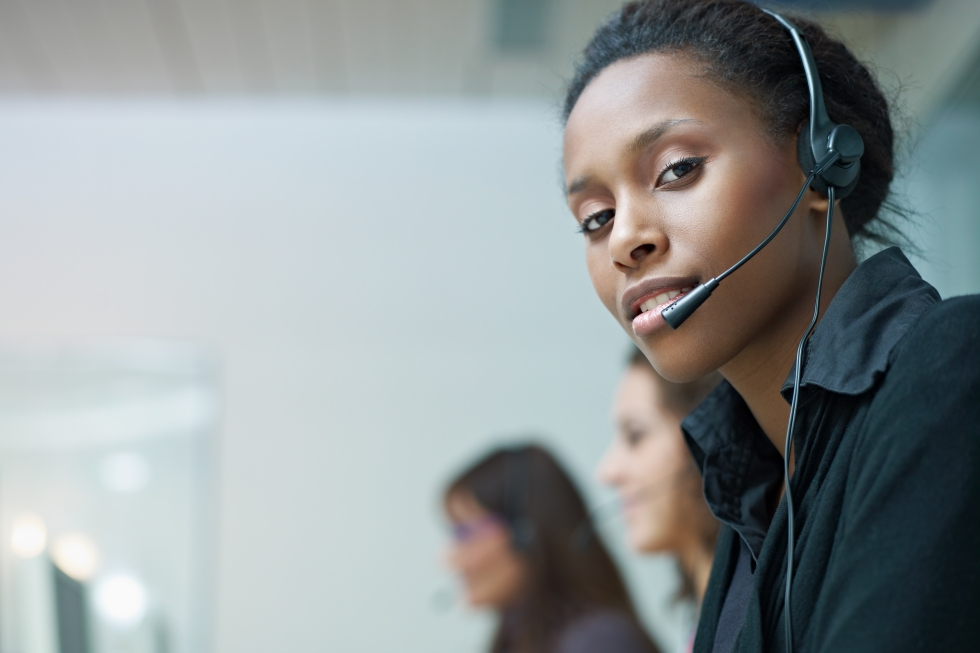 Women with headsets working at a call center