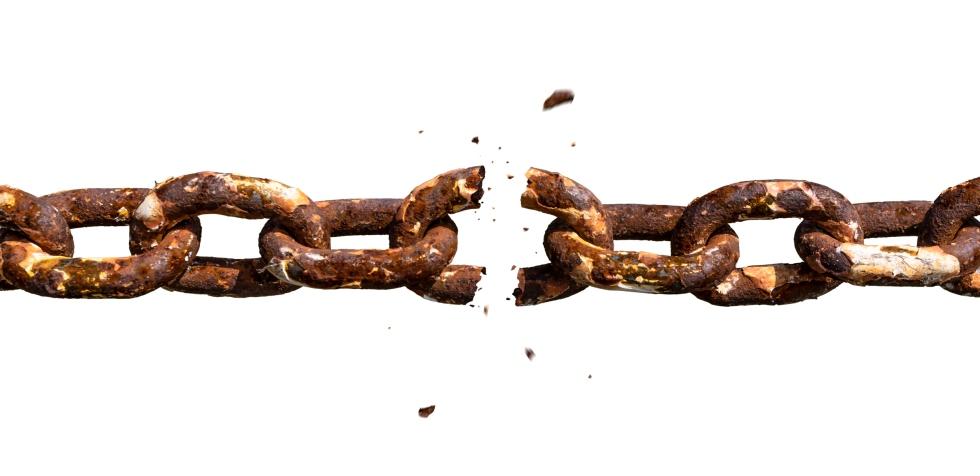 Weakest link breaking in old rusty chain photomontage