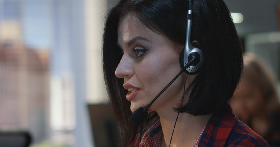 Woman talking with headset